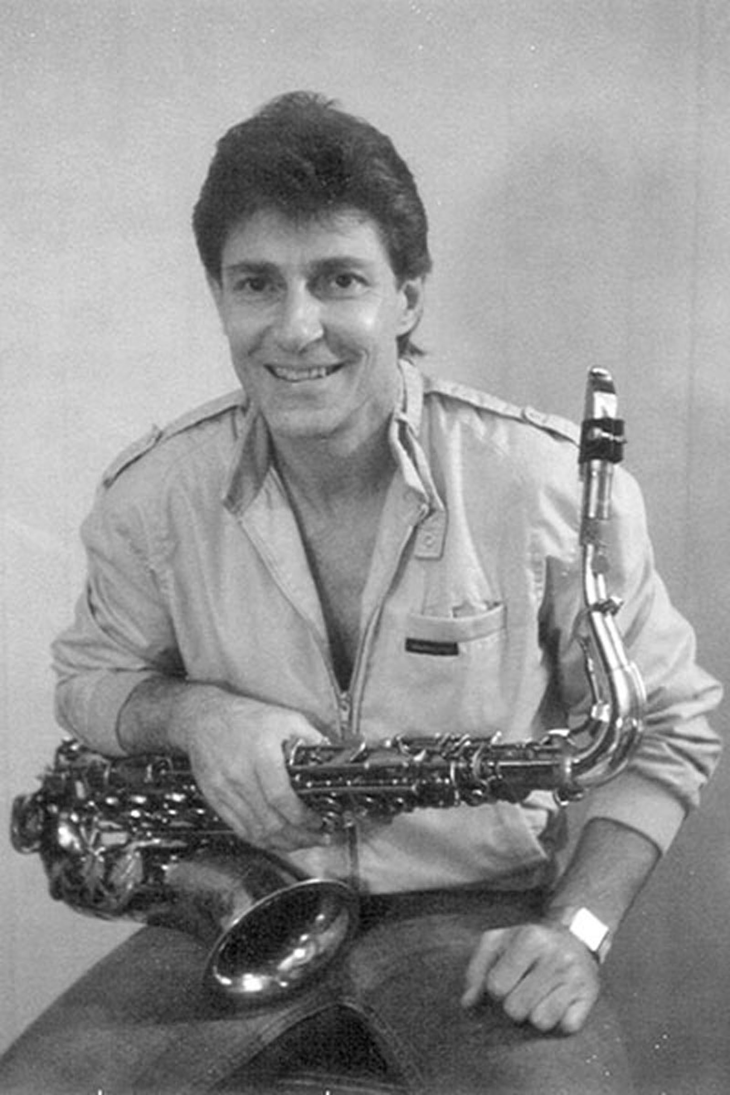 Professional headshot with his tenor sax